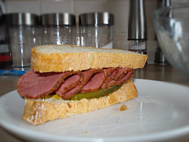 pastrami sandwich with pickle and mustard mayo