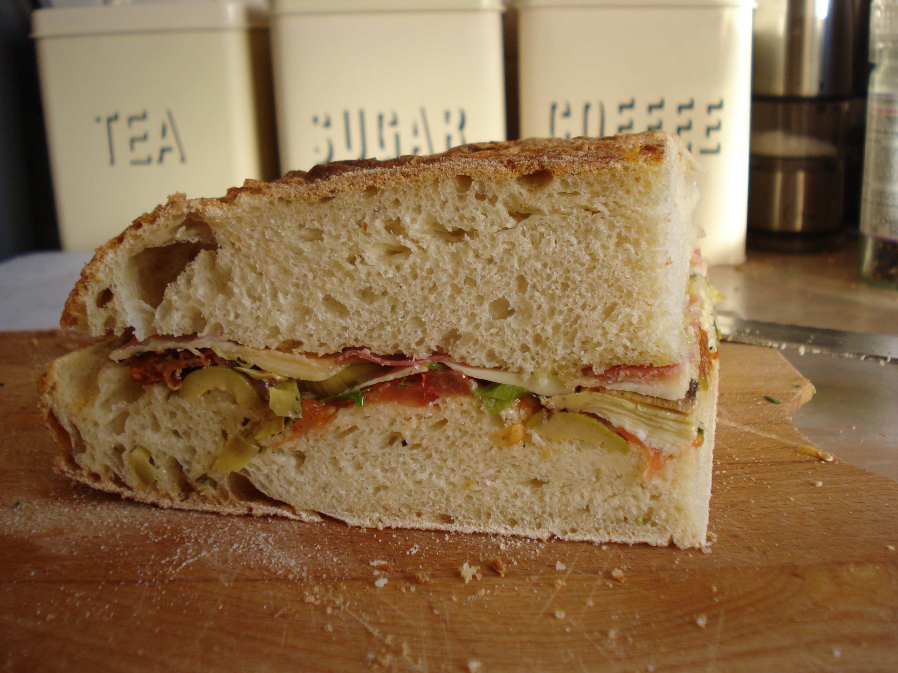 the lovely squished layers of a muffeletta sandwich