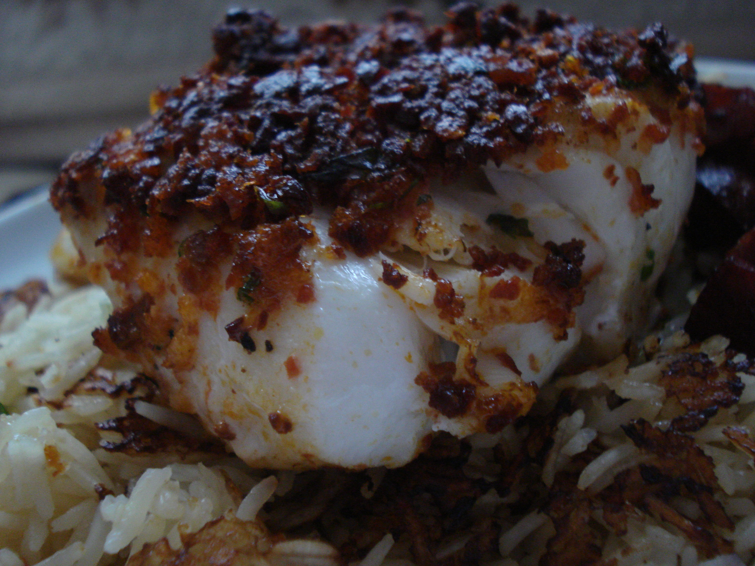 cod with a chorizo crust served with rice