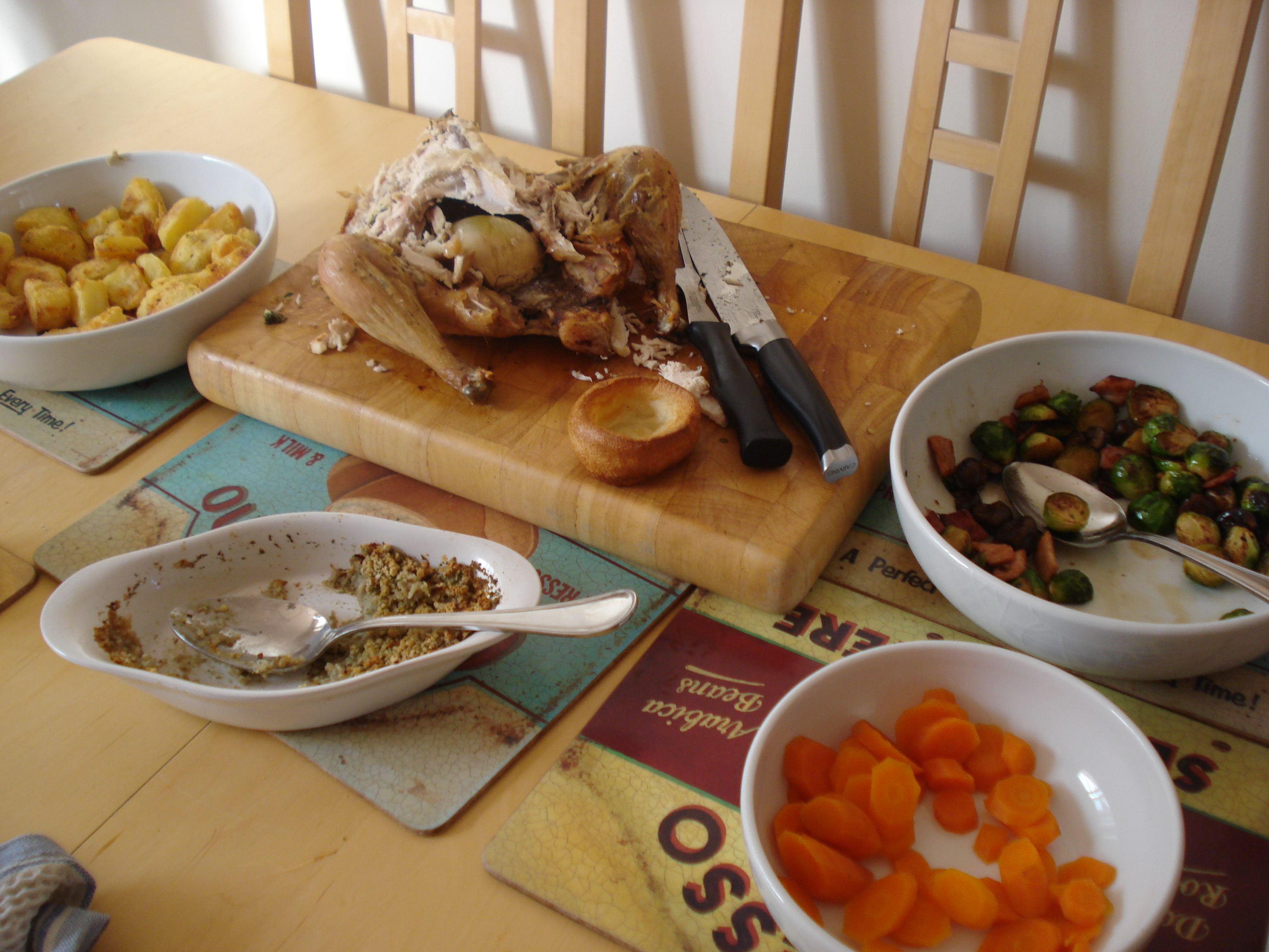 sunday roast chicken with roast potatoes, carrots and brussels sprouts