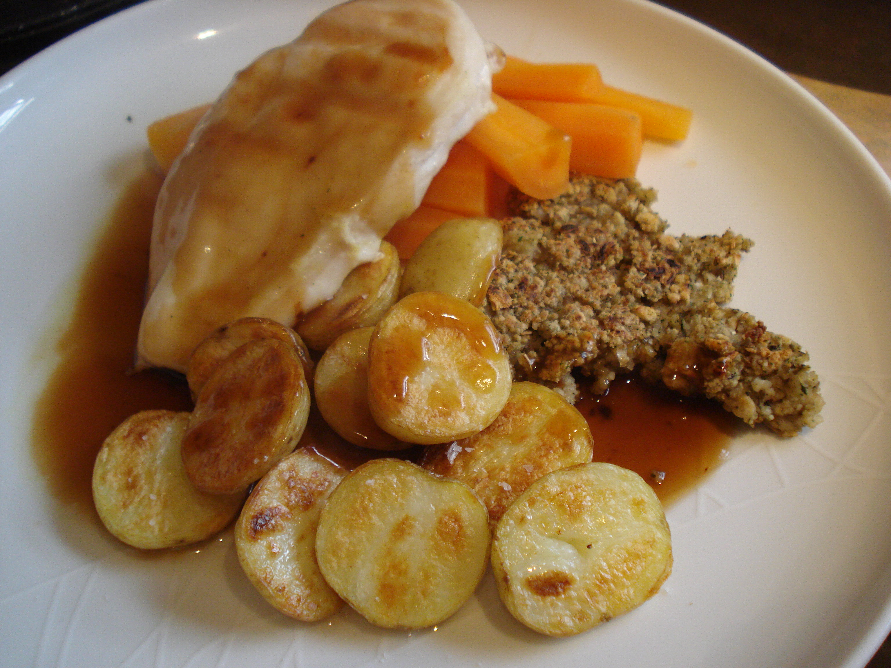 grilled chicken, roast potatoes, stuffing, carrots and gravy