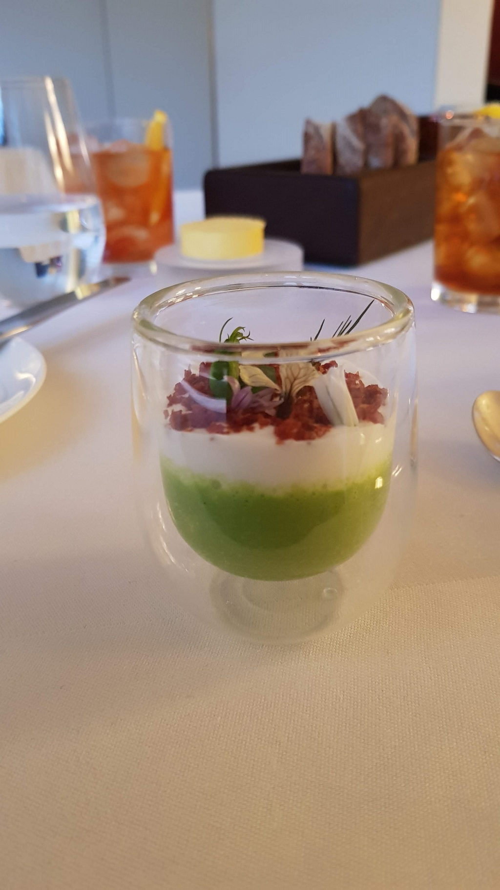 pea veloute with buttermilk foam at Petrus restaurant