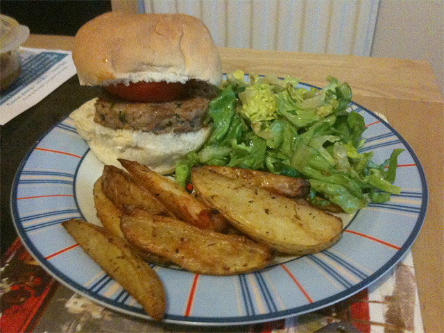 turkey burger with spicy potato wedges and caesar salad