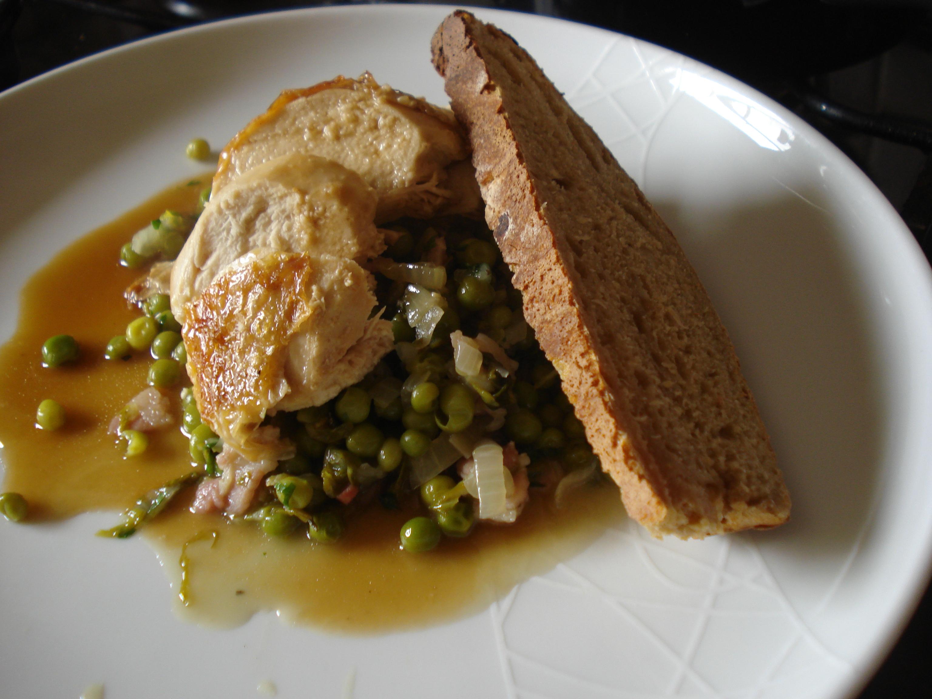 roast chicken with petits pois a la francais and sourdough bread