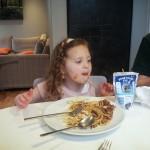 enjoying spaghetti bolognese