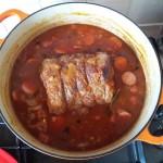 beef brisket simmering in feijoada